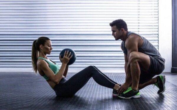 """alt=""""fitness coach training a beautiful lady to increase her fitness."""""""