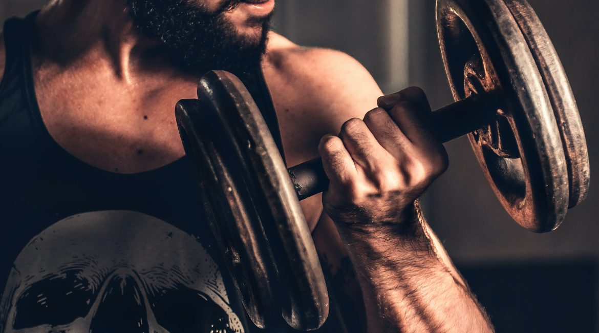"""alt=""""A well built man trying to achieve his health and fitness goals."""""""