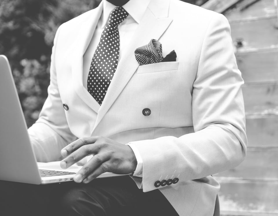 """alt=""""A Fit and Successful man dressed in a suit who used a coach to accomplish his dreams"""""""