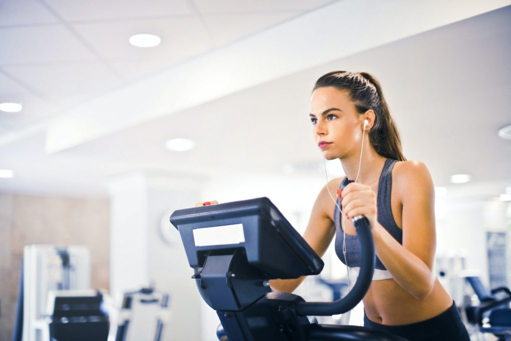 "alt="" Lady running on a treadmill to build her health and fitness levels."""