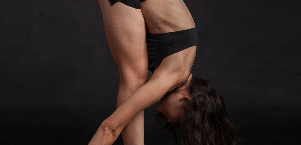 """alt=""""A young woman in a yoga position attempting to improve her sleep health"""""""