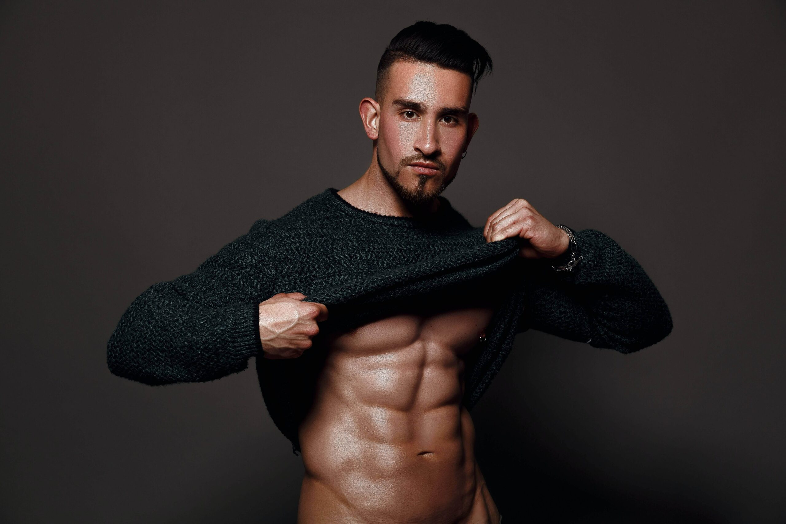 "alt=""Bodybuilder showing his improvements from bodybuilding"""